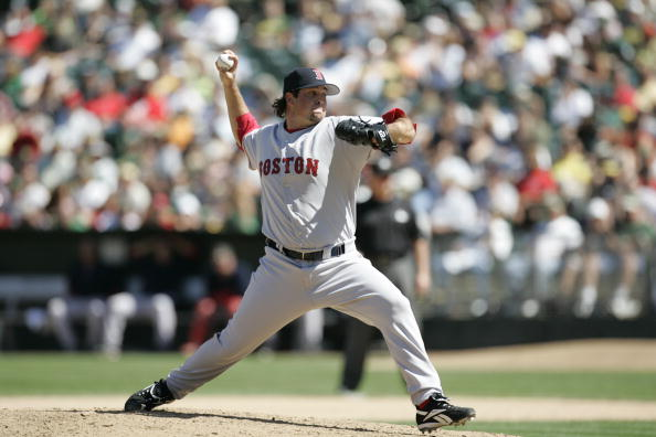 OAKLAND, CA - AUGUST 30:  Mike Burns of the Boston Red Sox pitches against the Oakland Athletics at McAfee Coliseum in Oakland, California on August 30, 2006.  (Photo by Michael Zagaris/MLB Photos via Getty Images)